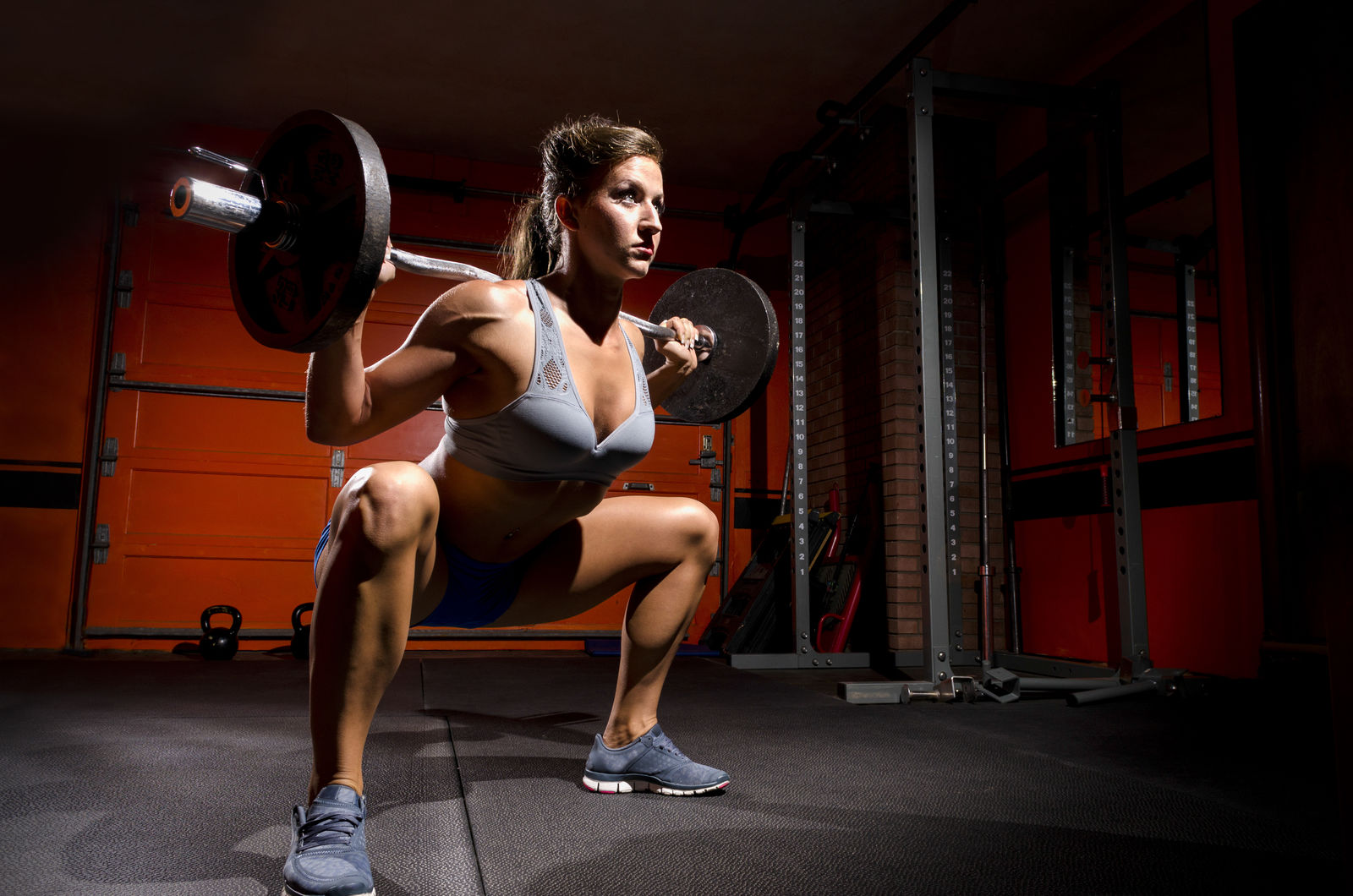 Watch this woman squat almost double her bodyweight!